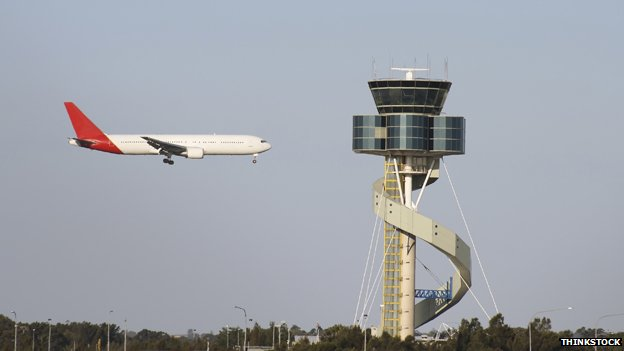 Air traffic control tower and plane