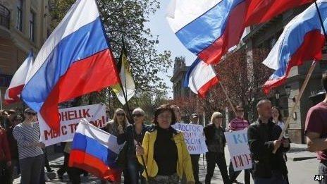 Demonstrators carry Russian flags in support of pro-Russian protesters in eastern Ukraine, in Simferopol, Crimea