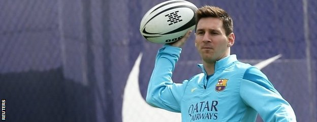 Lionel Messi with a rugby ball