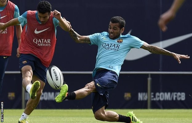 Dani Alves tackles Pedro while playing rugby