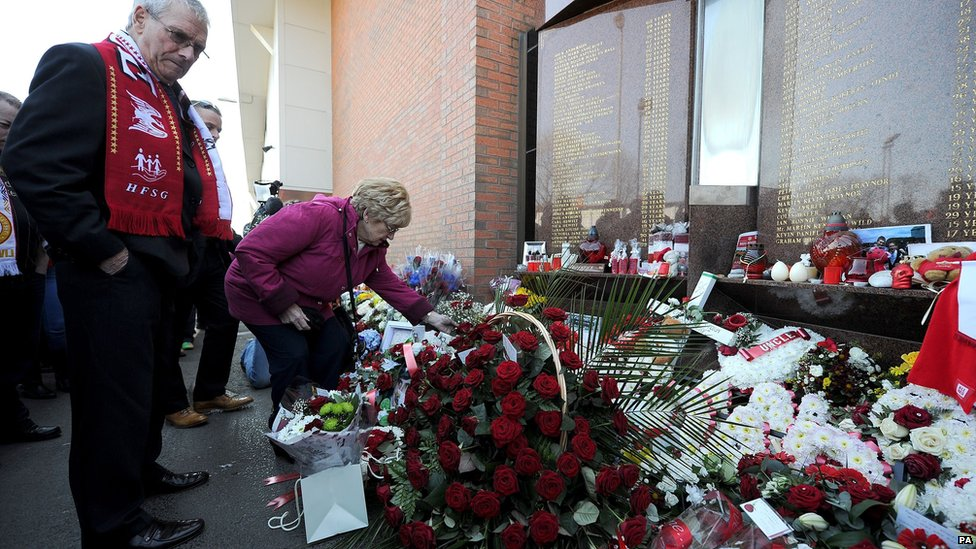 Flowers are laid outside Anfield before the memorial service to remember the 96 people who died at Hillsborough.