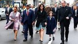 Massachusetts Governor Deval Patrick walks with his wife, Diane, and members of the victims families during a wreath-laying ceremony commemorating the one-year anniversary of the Boston Marathon bombings on Boylston Street near the finish line 15 April 2014