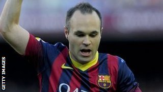 Andres Iniesta celebrates scoring against Osasuna