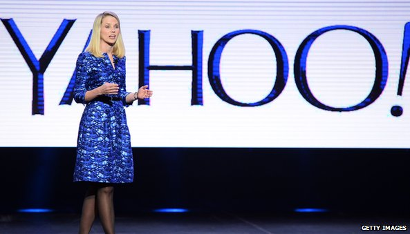Marissa Mayer in front of yahoo logo