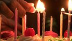 Candles are lit on a cake during celebrations in India, after the Supreme Court recognised a third gender