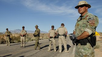 Federal law enforcement block a road in Nevada.