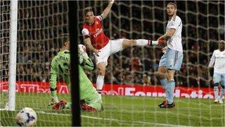 Olivier Giroud scores against West Ham