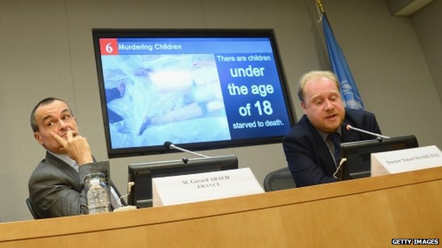 (L-R) UN representative from France Gerard Araud, and forensic pathologist Dr Stuart Hamilton give a report on the allegations of torture in Syria at the United Nations on 15 April 2014 in New York City.
