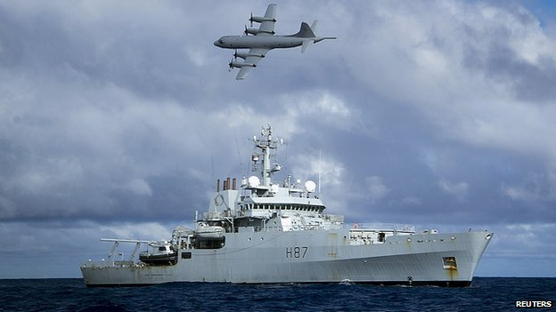 Royal Australian Air Force AP-3C Orion aircraft flies past British naval ship HMS Echo in southern Indian Ocean. 15 April 2014