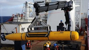 Operators aboard Ocean Shield move the Bluefin-21 autonomous underwater vehicle into position. 15 April 2014