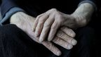 Hands of elderly person