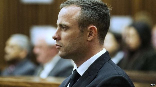 South African Paralympic track star Oscar Pistorius looks on during his trial at the North Gauteng High Court on 16 April 2014