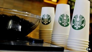 File photo dated 13/08/2013 of Starbucks takeaway cups at a Starbucks in central London,