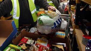 File photo dated 20/12/11 of workers at a food bank