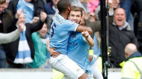 Manchester City players Fernandinho and Edin Dzeko