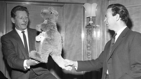 Michael Peacock, BBC Two chief of programmes, presents a toy kangaroo to US star Danny Kaye ahead of the channel's launch