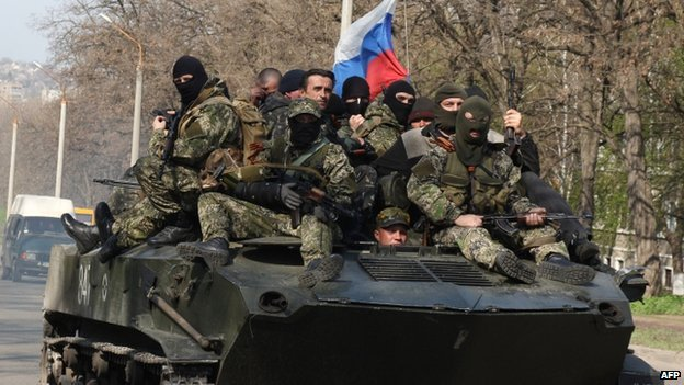 Armed men on a tank decorated with the Russian flag in the eastern Ukrainian city of Kramatorsk