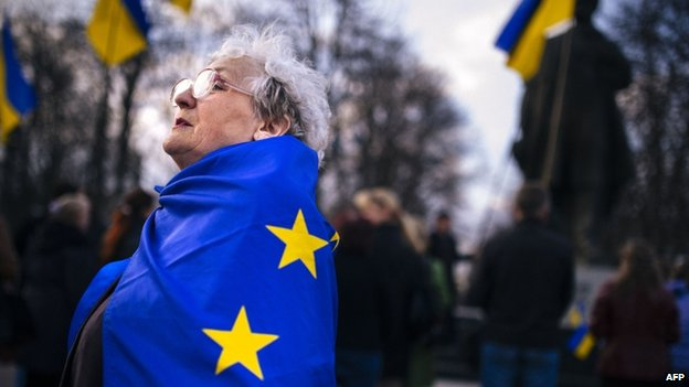 An elderly woman wrapped with an European Union flag attends a pro-Ukraine rally in the eastern Ukrainian city of Luhansk