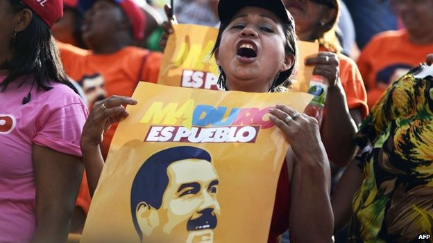 Supporters of Venezuelan President Nicolas Maduro are seen during an event celebrating his first year of government at Miraflores presidential palace in Caracas on 15 April, 2014