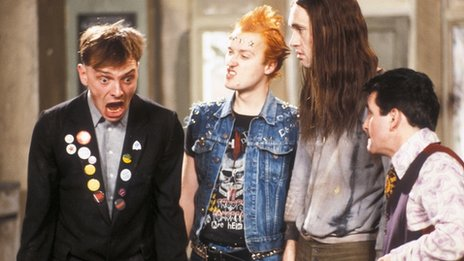 Rik Mayall, Adrian Edmonson, Nigel Planer and Christopher Ryan in The Young Ones 1984