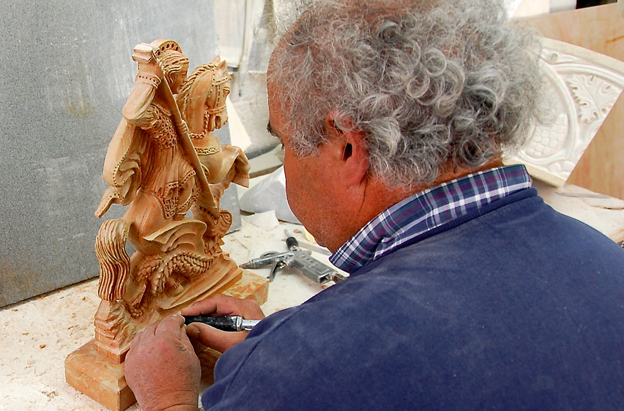 Mr Anastas is sculpting a small statue of St George slaying a dragon