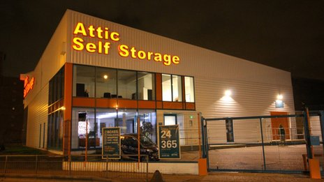 A self-storage unit at night