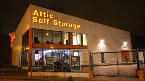 A self-storage unit at night