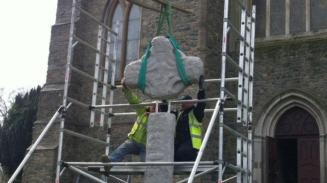 Almost there... The top of the High Cross is carefully set in place
