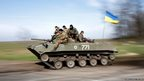 Ukrainian soldiers drive a combat vehicle near Kramatorsk, in eastern Ukraine