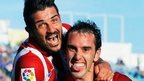 Atletico's Diego Godin celebrates his goal with teammate David Villa