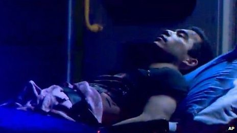 Matthew Douglas de Grood, of Calgary, is shown in this still image taken from video, courtesy Global News, on a stretcher in Calgary on 15 April 2014