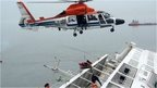 A helicopter rescues passengers who were on the South Korean ferry