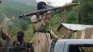 File photo: Pakistani Taliban fighters patrol in their stronghold of Shawal in Pakistani tribal region of South Waziristan, 5 August 2012