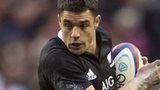 All Black fly-half Dan Carter takes on England's Manu Tuilagi