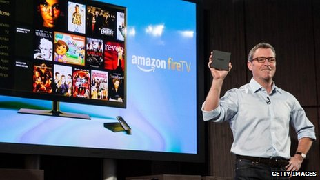 Amazon's vice president of Kindle, Peter Larsen, displays the Amazon Fire TV