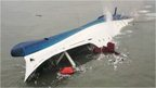 "South Korean ferry ""Sewol"" is seen sinking in the sea off Jindo April 16, 2014"