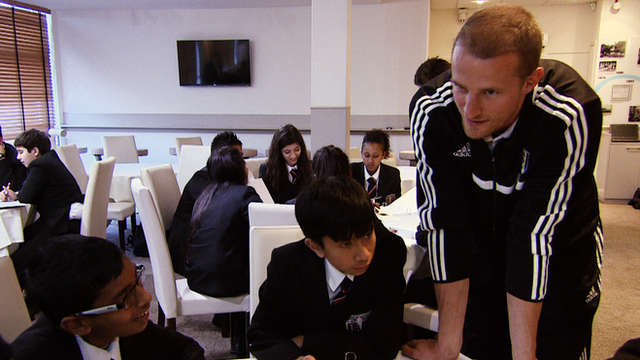Fulham captain Brede Hangeland speaks to children on the Health Champions course