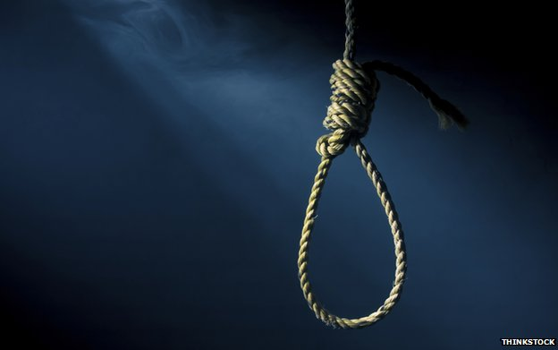 A noose on a dark background