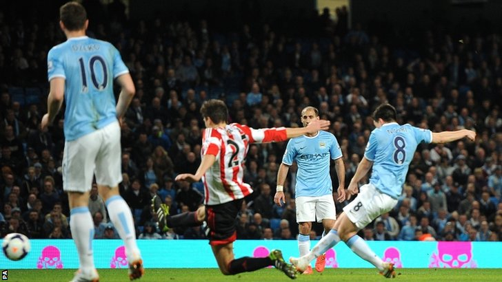 Manchester City's Samir Nasri scores his side's equaliser