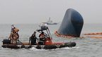 South Korea Coast Guard members search near a South Korean ferry after it capsized. 17 April 2014