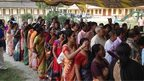 Voters line up outside a polling booth in West Bengal on 17, April, 2014