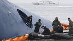 "Members of South Korean Ship Salvage Unit (SSU) search for passengers who were on the South Korea ferry ""Sewol"" which sank in the sea off Jindo on 17 April, 2014"