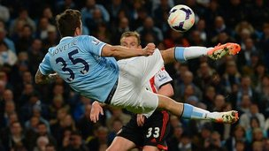 Manchester City player Stevan Jovetic kicking the ball against Sunderland.