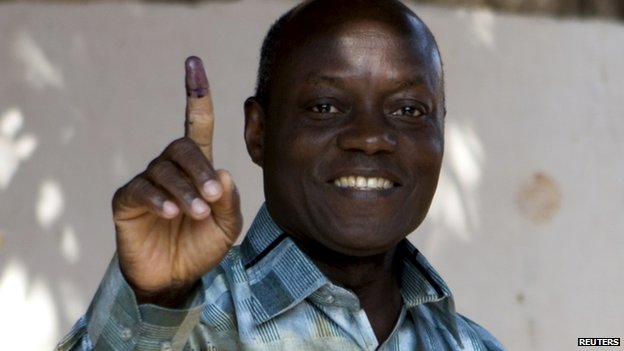 Presidential candidate Jose Mario Vaz shows his inked finger after voting in Bissau, Guinea-Bissau, 13 April 2014