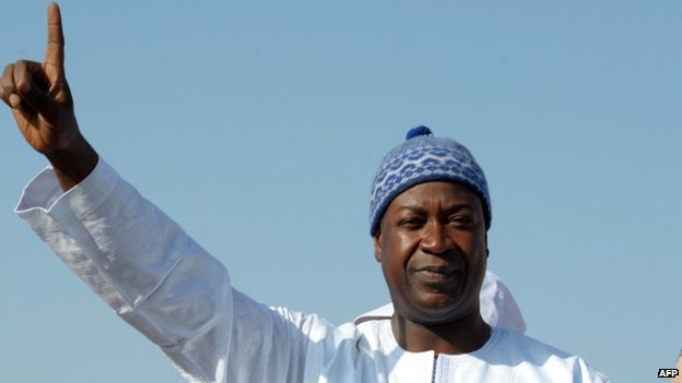 Independent presidential candidate Nuno Gomes Nabiam Guinea-Bissau gestures during a political rally in the capital, Bissau, on 11 April 2014