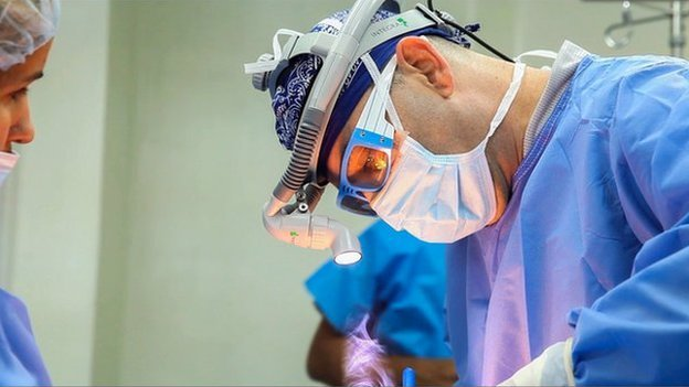 A surgeon operating on a patient