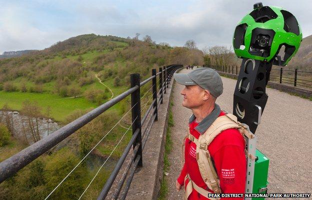 Peak District National Park Ranger with Google Trekker backpack on the Monsal Viaduct, Peak District