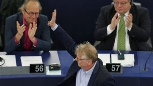 Daniel Cohn-Bendit waves as he is applauded by fellow MEPs after his last speech to the European Parliament in Strasbourg, 16 April