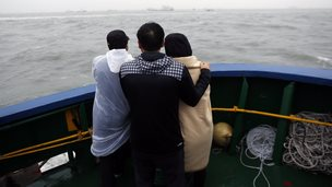 Family members of missing passengers view the rescue site