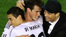 Gareth Bale (centre) embraced by Angel di Maria and Cristiano Ronaldo after scoring the winner in the Copa del Rey final